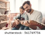 cute little girl and her... | Shutterstock . vector #561769756