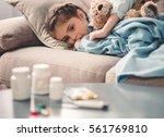 sick little girl covered in... | Shutterstock . vector #561769810