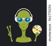 alien is a music lover.humanoid ... | Shutterstock .eps vector #561770254