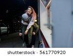 young longboard couple having...   Shutterstock . vector #561770920
