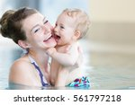 mother and her newborn child at ... | Shutterstock . vector #561797218
