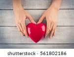 Red Heart In Hands Closeup On...