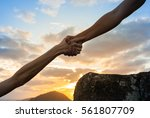giving a helping hand.  | Shutterstock . vector #561807709