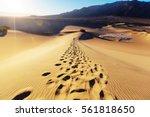 hiker in sand desert. sunrise... | Shutterstock . vector #561818650