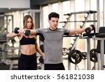 female personal trainer helping ... | Shutterstock . vector #561821038