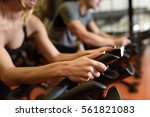 two people biking in the gym ... | Shutterstock . vector #561821083