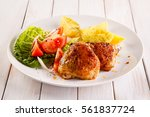 grilled chicken thighs with... | Shutterstock . vector #561837724