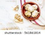 garlic cloves and garlic bulb... | Shutterstock . vector #561861814