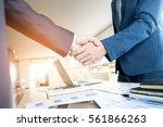 two confident business man... | Shutterstock . vector #561866263