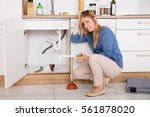 young frustrated woman having... | Shutterstock . vector #561878020