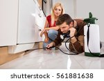 woman looking at exterminator... | Shutterstock . vector #561881638
