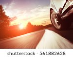 the car moves at fast speed at... | Shutterstock . vector #561882628