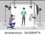male model in photo studio.... | Shutterstock .eps vector #561884974