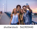 friends having fun outdoors.... | Shutterstock . vector #561905440