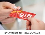 close up of person hand giving... | Shutterstock . vector #561909136