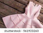 light salmon dress with folds.... | Shutterstock . vector #561923263