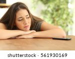 sad girl waiting for a phone... | Shutterstock . vector #561930169