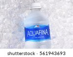 Small photo of IRVINE, CALIFORNIA - JANUARY 22, 2017: Aquafina Water Bottle on ice. The purified water brand is produced by PepsiCo, in both flavored and unflavored varieties.