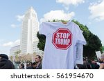 Small photo of Los Angeles, USA - January 21, 2017: Activist holds a t-shirt about President Trump during Women's March Los Angeles in Downtown LA.