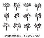 set of black trees and leafs.... | Shutterstock .eps vector #561973720