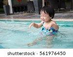 Asian Toddler Having Fun In Th...