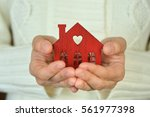 warm and cozy miniature house... | Shutterstock . vector #561977398