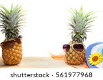 pineapple with sunglasses and... | Shutterstock . vector #561977968