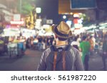 young asian traveling... | Shutterstock . vector #561987220