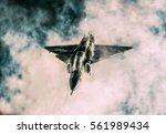 military fighter plane flying... | Shutterstock . vector #561989434