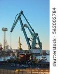 dockside cranes  containers ... | Shutterstock . vector #562002784