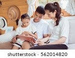 asian family tablet are playing ... | Shutterstock . vector #562014820
