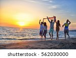 group of happy young people... | Shutterstock . vector #562030000
