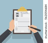resume form in hands. clipboard ... | Shutterstock .eps vector #562054684