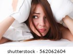 female lying on bed and closing ... | Shutterstock . vector #562062604
