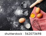 baking background with flour ... | Shutterstock . vector #562073698