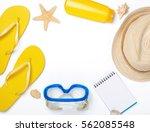 frame of beach accessories on... | Shutterstock . vector #562085548