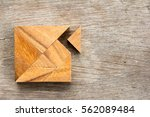 tangram puzzle with one piece... | Shutterstock . vector #562089484