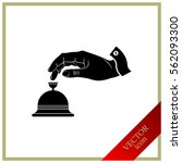 hotel bell and hand icon. | Shutterstock .eps vector #562093300
