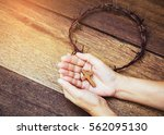 Wooden Cross In Hands With...