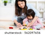 pretty happy japanese mother... | Shutterstock . vector #562097656