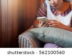 young asian woman using mobile... | Shutterstock . vector #562100560