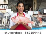 laughing woman selling fresh... | Shutterstock . vector #562104448