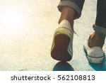 woman walking on the street at... | Shutterstock . vector #562108813