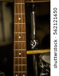 Small photo of snare drum with drumsticks and bass guitar, closeup, concept musical composition and creativity