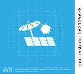 beach umbrella and chaise... | Shutterstock .eps vector #562129678
