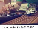 man using calculator calculate... | Shutterstock . vector #562135930