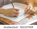 students concentration holding... | Shutterstock . vector #562137409