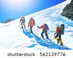 group of climbers reaches the... | Shutterstock . vector #562139776
