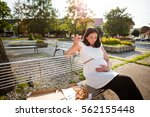 pregnant woman eating unhealthy ... | Shutterstock . vector #562155448