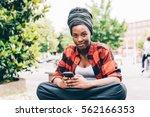 young beautiful black woman... | Shutterstock . vector #562166353